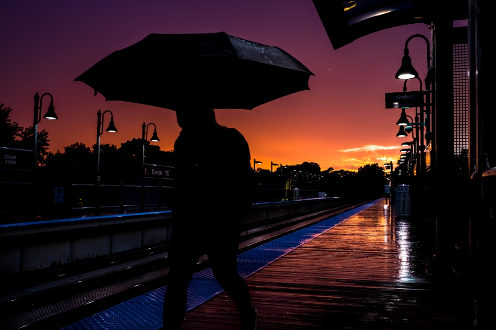 "Sunset at a Chicago ""L"" station. (Photo: Lukas Keapproth)"